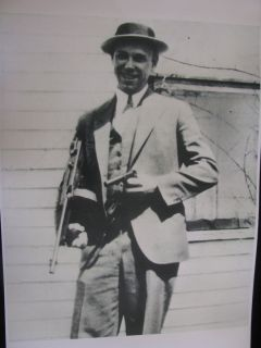 JOHN DILLINGER WITH THOMPSON SUB MACHINE GUN AND AUTOMATIC PISTOL