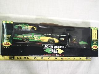 JOHN DEERE SEMI TRANSPORTER WITH CAR # 23, 1996, 1/64 TRUCK TRACTOR