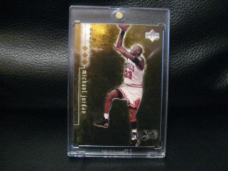 1999 Upper Deck Black Diamond Michael Jordan Triple Diamond Gold card