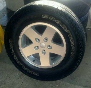 Goodyear SR A Tires w 2012 Stock Jeep Wrangler Rims