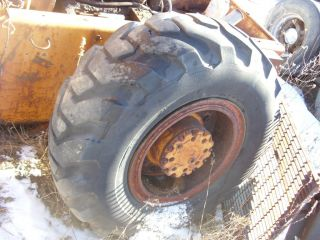 Used Wheel Loader Tire on Case Rim Firestone 12 Bolt Rim Wheel